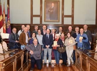 Un grupo de jubilados de Ibercaja visita el Palacio Provincial