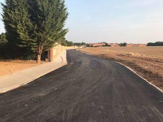 Pozo de Guadalajara asfalta la avenida de la Constitución y el acceso urbano al barrio Montepozo