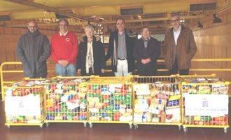 Los alimentos 'solidarios' de Naviguad ya están en manos de Cruz Roja y Cáritas