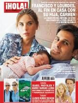 ¡HOLA!: Francisco y Lourdes en una tierna imagen junto a su hija Carmen.